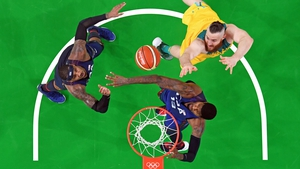USA's Carmelo Anthony and Paul George go for a rebound with Australia's Aron Baynes