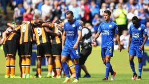 Leicester players leave the field dejected following defeat