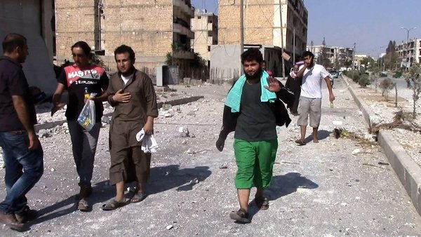 Syrians are seen returning to their homes in al-Sirb neighbourhood in Manbij