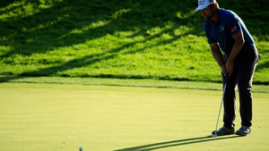 Ryan Moore plays a shot on the tenth hole during the third round of the John Deere Classic