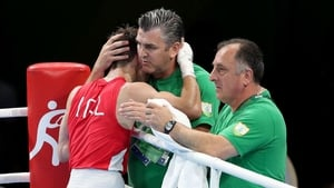 John Conlan embraces his son Michael after his opening victory in Rio