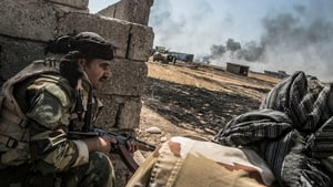 Peshmerga forces take cover as they begin an operation to liberate several villages currently under the control of IS southeast of Mosul, Iraq
