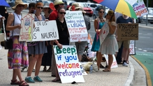 Activists protesting in Brisbane over the case of a baby girl who suffered burns while in detention on Nauru