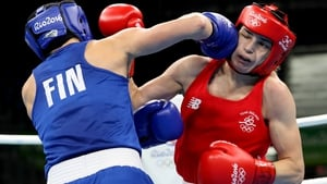 Mira Potkonen rocks Katie Taylor with a powerful straight right in Rio
