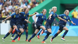 The Swedish players celebrate after Lisa Dahlkvist scored the decisive penalty