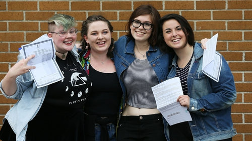 Megan Cassidy, Sibeal Ni Mhaoileoin, Phoebe Kelly McDonnell and Hazel O'Kelly, after collecting their Leaving Certificate exam results at Mount Temple School in Dublin