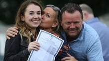 A delighted Sally-Anne Cash celebrates with her parents Margaret and Donal