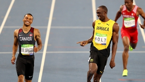 All smiles for Andre De Grasse and Usain Bolt