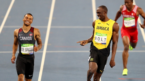 Andre de Grasse (L) won silver in the 200m and bronze in the 100m behind Usain Bolt in Rio
