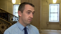 Sinn Féin councillor and 18 activists quit party