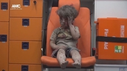 Boy pulled from rubble after Aleppo airstrike