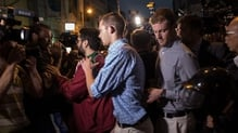 US Olympic swimmers Gunnar Bentz (L) Jack Conger (R) leaving a police station in Brazil