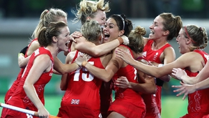 Great Britain players celebrating winning the shoot out against Netherlands to win the Women's Gold Meda