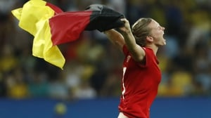 Germany's striker Alexandra Popp runs with a flag as she celebrates her team's victory over Sweden