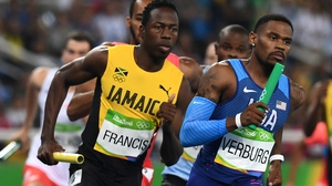 Jamaica's Javon Francis and USA's David Verburg compete in the Men's 4x400m Relay Round 1