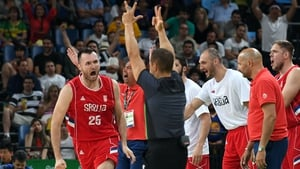 Serbian players and management celebrate during their semi-final with Australia