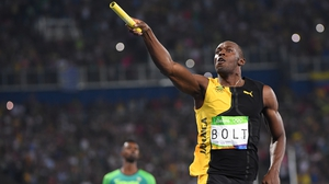 Usain Bolt celebrates after running the anchor leg for Jamaica