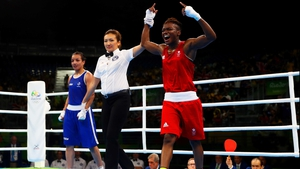Nicola Adams has her arm raised aloft in Rio