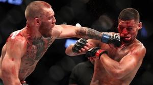Conor McGregor lands a punch on Nate Diaz at UFC 202