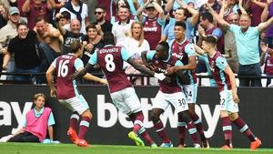 Michail Antonio celebrates scoring the winning goal with team-mates