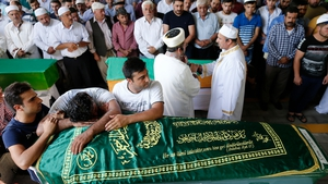 Relatives attend the funerals of some of the victims who were killed in the bomb attack in Gaziantep