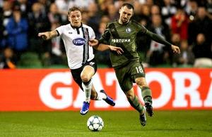 Dundalk's John Mountney battles for possession against Michal Kucharczyk of Legia Warsaw