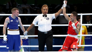 Paddy Barnes fell at the first hurdle after a surprise split-decision defeat to Spain's Samuel Carmona Heredia.