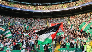 Fans flew Palestine flags before and during the match