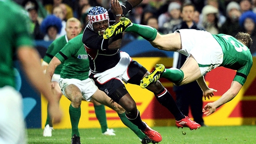 Ireland's Brian O'Driscoll (R) goes flying after colliding with with USA's Takudzwa Ngwenya during the 2011 World Cup