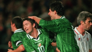 Niall Quinn congratulates Keane following his first international goal against Malta in 1998