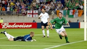 Robbie Keane wheels away in celebration after scoring late on against Germany at the 2002 World Cup