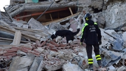 Rescue teams worked through the night to try to find survivors under the rubble
