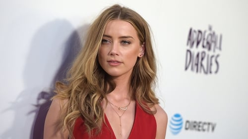 Amber Heard is pledging to stick to her promise to donate her divorce settlement to charity