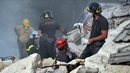 Rescue workers search the rubble in Amatrice