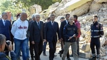 President Sergio Mattarella (3rd L) walks with Amatrice mayor Sergio Pirozzi (2nd L) in the damaged Italian village