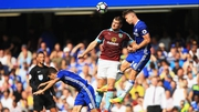 Burnley's Sam Vokes and Gary Cahill of Chelsea compete for the ball at Stamford Bridge