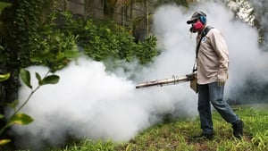 A mosquito control inspector sprays pesticide to kill mosquitos in the Miami Beach area