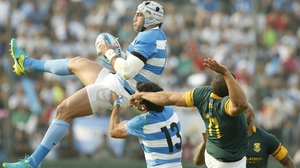 Argentina's Juan Manuel Leguizamon fights for the ball with Bryan Habana