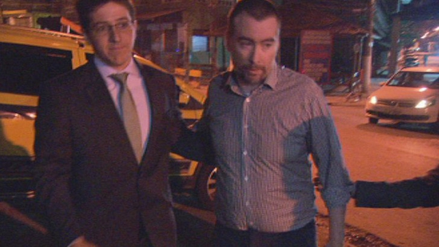 Kevin Mallon (R) left Bangu prison without making any comment