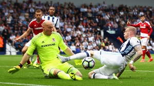 Brad Guzan saves from James McClean