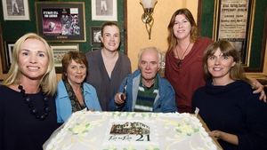 Actors who have been with Ros na Rún since the very first season celebrate the soap's milestone 21st Birthday in the pub Tigh Thaidhg. Máire Éilis Ní Fhlaithearta is at far left and Fionnuala Ní Fhlatharta on far right.