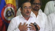 FARC leader Timoleon Jimenez speaks during a press conference with other members of his delegation in Havana