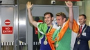 Paul and Gary O'Donovan wave to the crowd at Cork airport last night