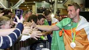 Paul and Gary O'Donovan (r) were greeted by about 1,000 fans when they arrived at Cork Airport