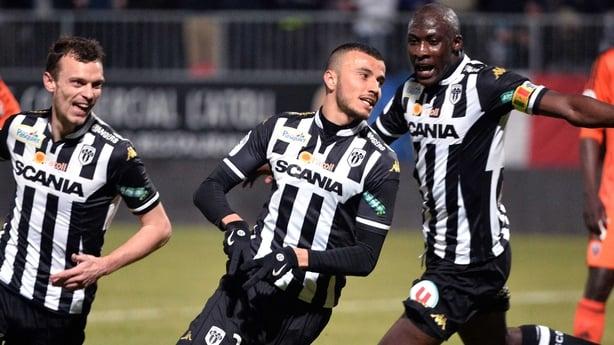 Romain Saiss celebrates a goal for Angers