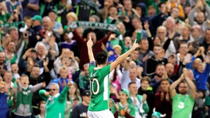 Robbie Keane salutes the crowd after his goal