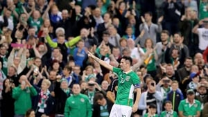 Roy Keane takes the adulation from the Irish fans after he scored his final goal for Ireland
