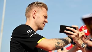 Kevin Magnussen signs autographs before the Grand Prix of Hungary