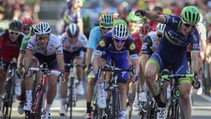 Jens Keukeleire (R) crosses the line first