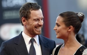 Michael Fassbener and Alicia Vikander on the red carpet in Venice